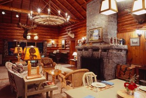 Classic lodge with stone fireplace & grand piano